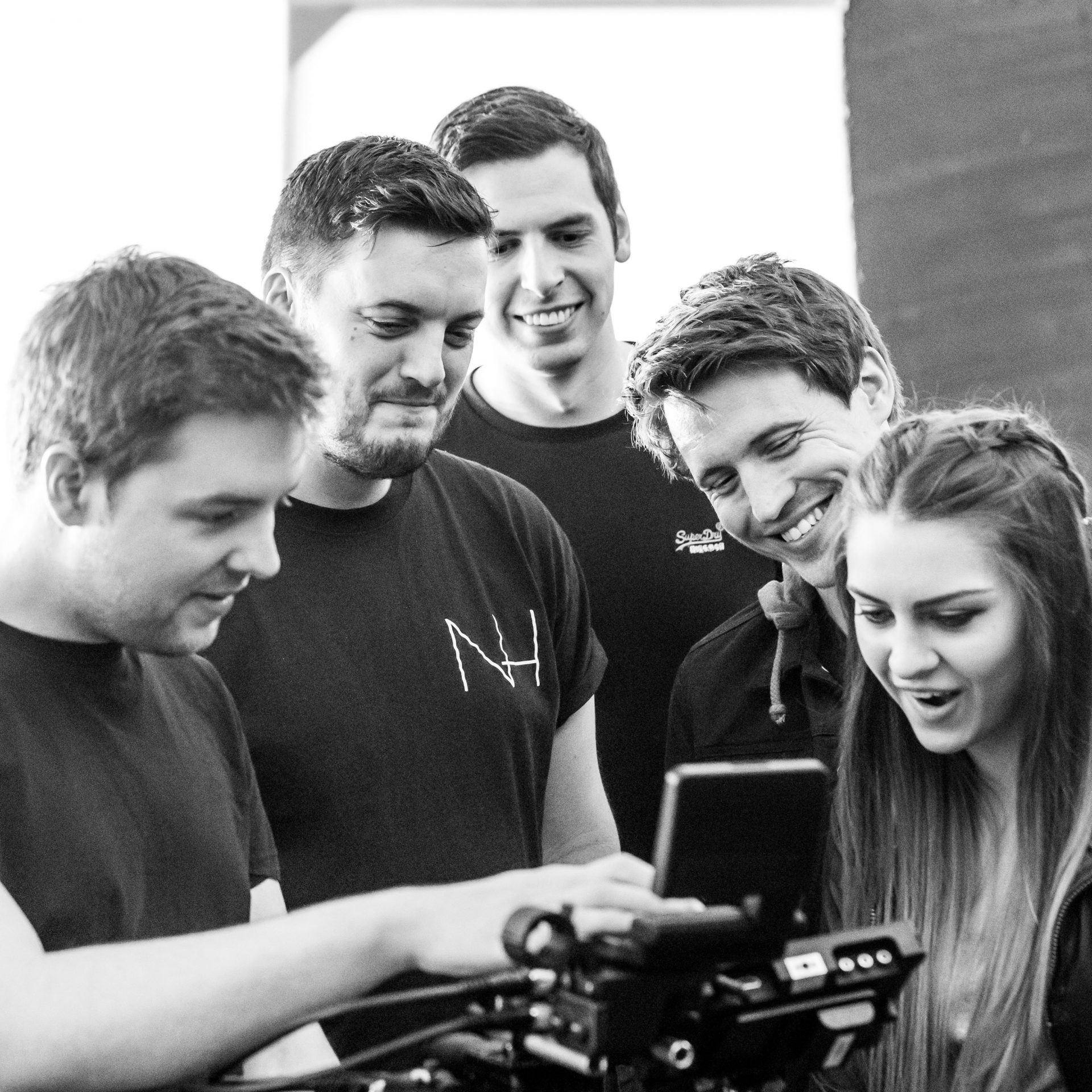 Creative Director Tom and the band watch through one of the takes during filming