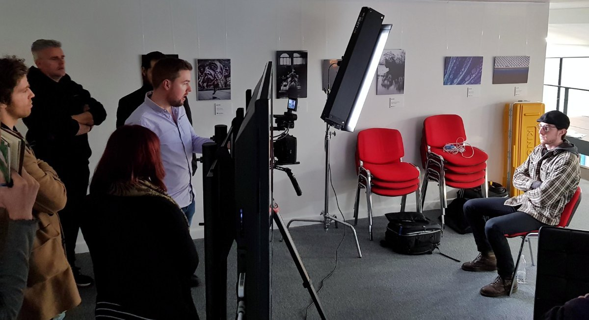 Tom demonstrating how to light and expose an interview during the masterclass